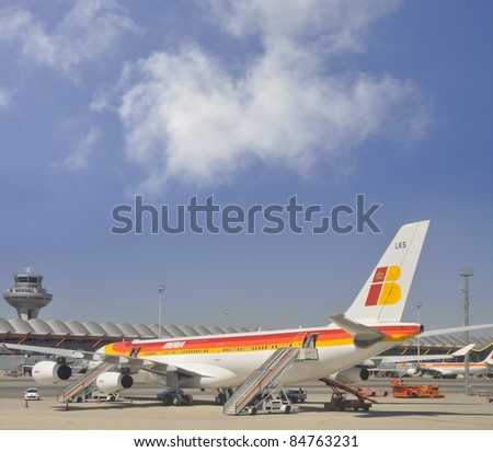 MADRID, SPAIN -SEPT 15: Iberia Airbus A340-300 airplane at Madrid Barajas Airport with external steps used to unload passengers in Madrid on Sept 15, 2011. Iberia flies to 102 cities in 39 countries.