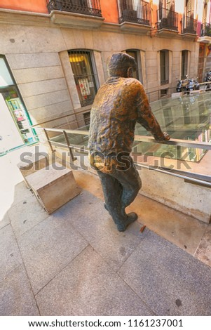 Madrid, Spain 06/18/2018: There is legend about this sculpture in the center of Madrid : if to touch the back of this man ,it will be  good luck in all things. We can see that many believe this legend #1161237001