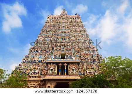 MADURAI, INDIA - MARCH 22: Meenakshi Temple - one of the biggest and oldest temple on March 22, 2012 in Madurai, India. Its about 2500 years old. The 14 gateway towers ranging from 45 to 50m.