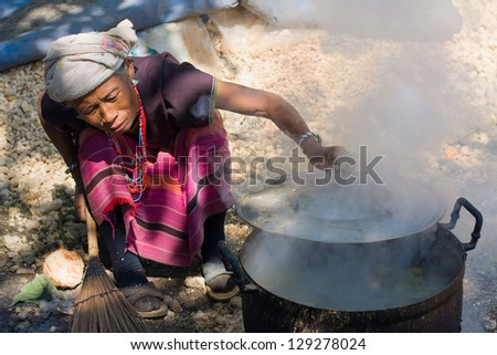MAE HONG SON - NOVEMBER 12: Unidentified woman Lahu tribe is cooking November 12, 2011 in Mae Hong Son, Thailand. The Lahu tribe that came from Tibetan has settled in Thailand not long ago.
