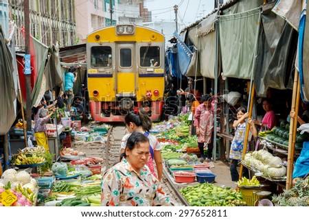 MAEKLONG, AUG 25: Train passing through the famous open air railway markets at Maeklong. Three times a day the train runs through these stalls  on August 25, 2008. Samutsongkram Province, Thailand