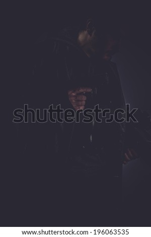 mafia, portrait of stylish man with long leather jacket, gun armed