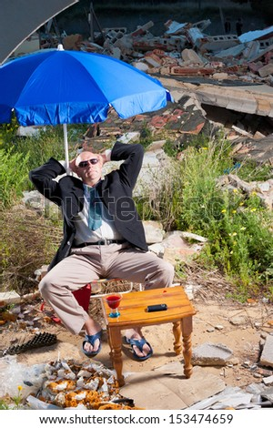 Mafia type of guy sunbathing surrounded by rubble, a concept