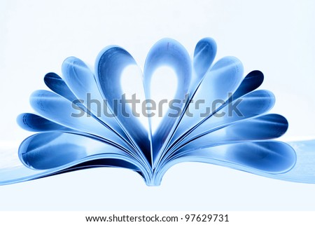 Magazine folded to heart shape isolated on white