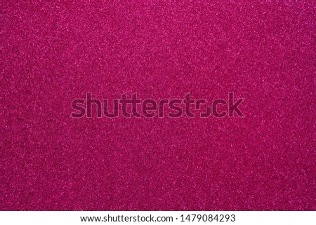 Magenta glitter abstract shiny background. Design paper texture for decoration and design of Christmas, New Year or other holiday pictures. Beautiful packaging material.