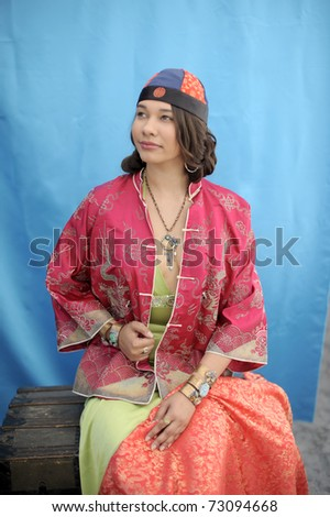 Magic antique trunk with a beautiful young woman in asian clothes.