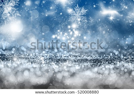 Magic blue holiday abstract glitter background with blinking stars and falling snowflakes. Blurred bokeh of Christmas lights. #520008880