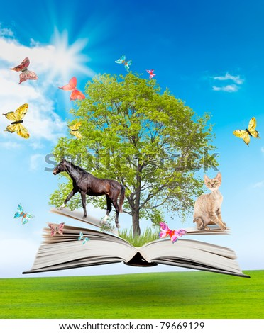 Magic book with a green tree and diferent animals on the background of nature. Symbol of knowledge.