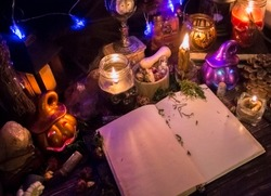 magic book with blank sheets for adding text, holiday halloween, samhain, candles and pumpkin jack lantern, witchcraft, ritual