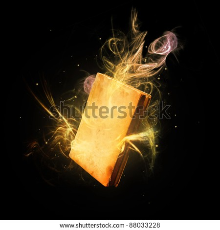 Magic book with colorful light rays and streaks.