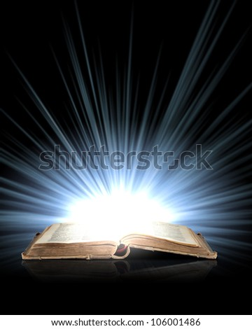 Magic book with light coming from inside it