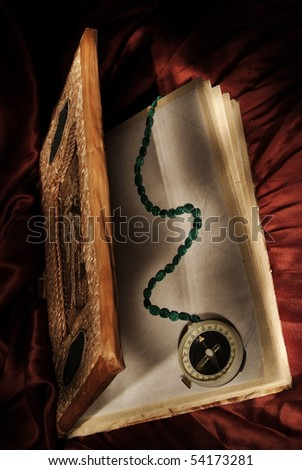 Magic book with wizard  compass - stock photo