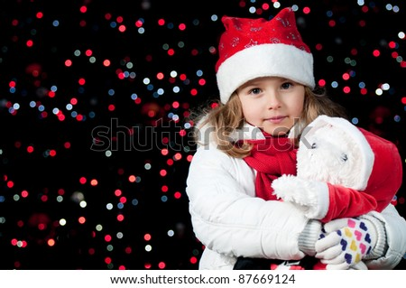 Magic Christmas lights - cute girl at Christmas night (no-name toy)