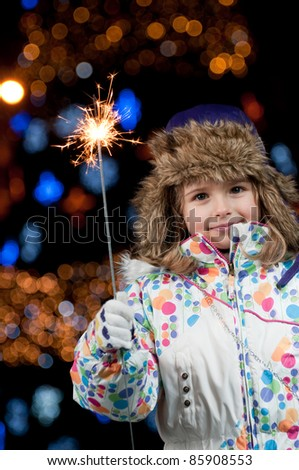Magic Christmas night - little girl celebrate Christmas (Defocused Christmas Tree Lights)