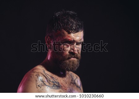 Magic, enchantment, witchcraft. Hipster with beard, mustache on serious dirty face. Bearded man with tattoo on chest skin. Wizard, sorcerer, warlock. Halloween, holidays celebration, copy space #1010230660