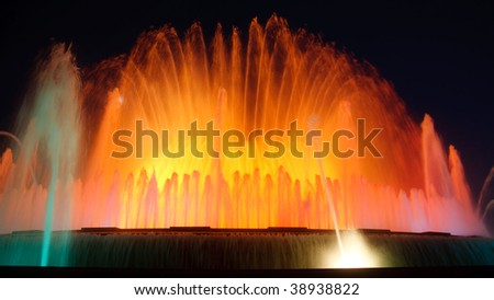 Magic Fountain of Montjuic, Barcelona, Spain. Night shot with long exposure and blurred colorful water.