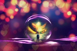 Magic glass ball display back view portrait of young man standing against the sea with big wave beating with splash in a stair to heaven ,Conceptual of freedom life.
