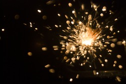 Magic glowing Flow of Sparks in the Dark. Sparks