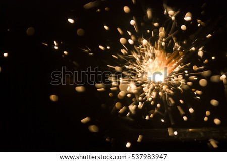 Magic glowing Flow of Sparks in the Dark. Sparks #537983947