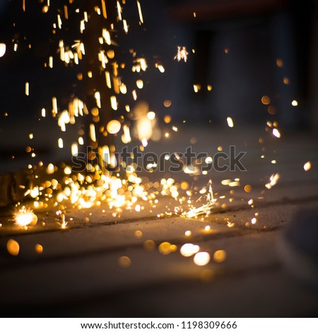 Magic glowing Flow of Sparks in the Dark. Sparks. Glitter vintage lights background.  #1198309666