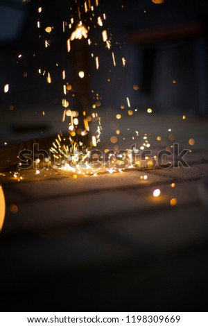 Magic glowing Flow of Sparks in the Dark. Sparks. Glitter vintage lights background.  #1198309669