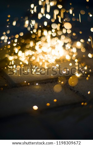 Magic glowing Flow of Sparks in the Dark. Sparks. Glitter vintage lights background.  #1198309672