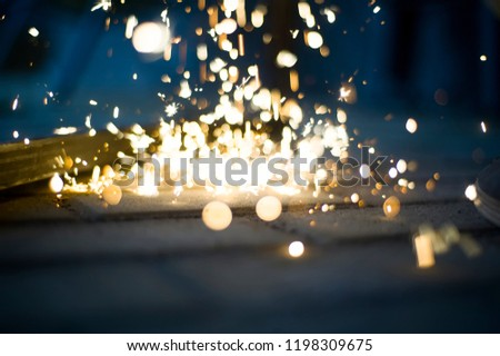 Magic glowing Flow of Sparks in the Dark. Sparks. Glitter vintage lights background.  #1198309675