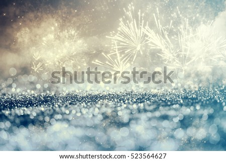 Magic holiday abstract glitter background with blinking stars and falling snowflakes. Blurred bokeh of Christmas lights. #523564627