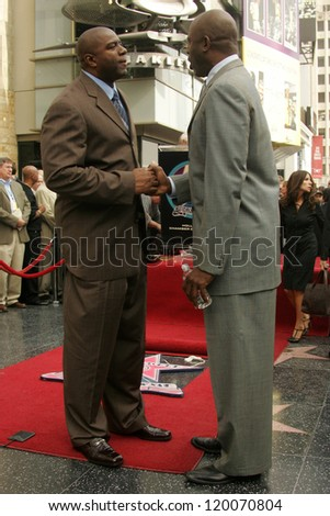 Magic Johnson and James Worthy at the Ceremony Honoring Los Angeles Lakers Owner Jerry Buss with the 2,323rd star on the Hollywood Walk of Fame. Hollywood Boulevard, Hollywood, CA. 10-30-06
