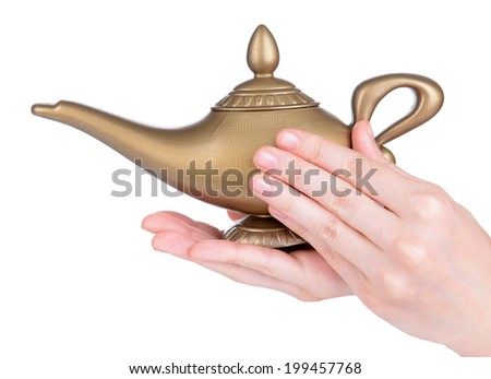 Magic lamp in female hands isolated on white #199457768