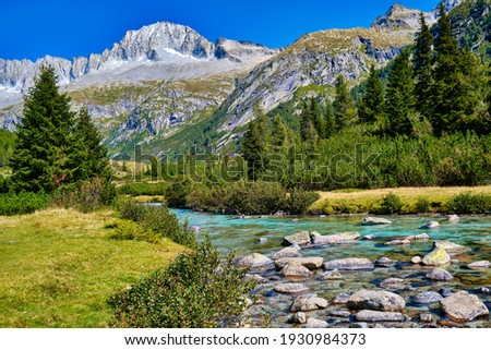 Magic montain river with summer mountains in Val di Fumo, in Adamello-Brenta National park. Blue sky upon a beautiful italian Dolomites mountains landscape with forest. Italian tourism Zdjęcia stock ©