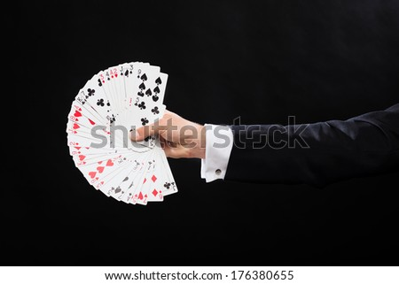 magic performance circus gambling casino poker show concept close up of magician hand holding playing cards