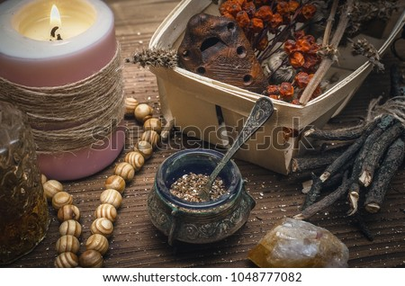 Magic potion. Alternative herbal medicine. Shaman table with copy space. Druidism concept. Witch doctor desk background. #1048777082