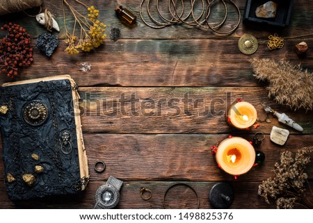 Magic recipe book and a magic potions on a table. Witchcraft background with copy space. Druid or witch doctor table.