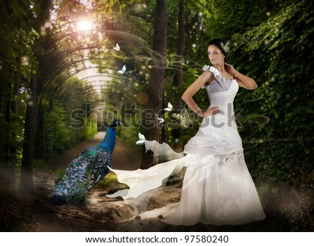 Magic scene in the wild park with fairy girl and peacock. - stock photo