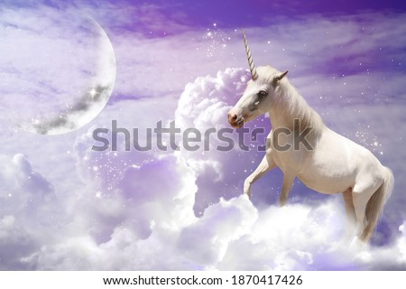 Magic unicorn in fantastic sky with fluffy clouds and crescent  Stock photo ©