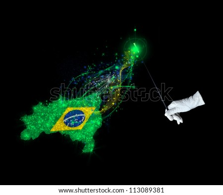 Magic wand and the Brazilian  flag on a black background