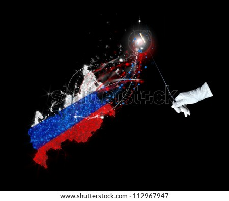 Magic wand and the Russian flag on a black background