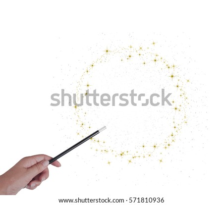 Magic wand in hand isolated on white. Gold stars. With copy space. Make wishes come true. #571810936