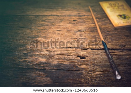 Magic wand on wooden table, Magic wand Wizard tool on vintage wooden background. #1243663516