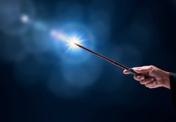 Magic wand with sparkle on blue background, Miracle magical stick Wizard tool on hot blue.