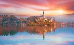 Magical autumn landscape with the island on Lake Bled (Blejsko jezero). Julian Alps, Slovenia, Europe. Attractions. Tourist places of pilgrimage. (Meditation,inner peace, harmony, honeymoon - concept)