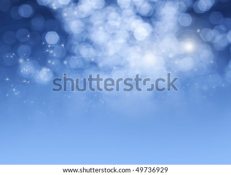 magical blue background with sparkles and bokeh.