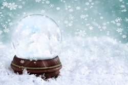 Magical Christmas snow globe with clouds and copy space inside. Shallow depth of field with selective focus on snowglobe.