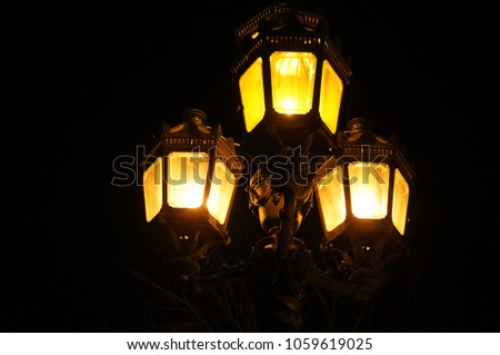 Magical mysterious lantern glows in the dark. Glowing lamp in the night #1059619025