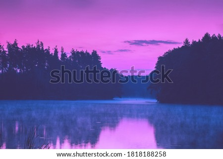 Photo of  Magical pink sunset over the lake. Serene lake in the evening. Nature landscape
