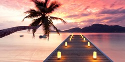 magical place for recreation and romantic hours, lightning wooden jetty on tropical beach