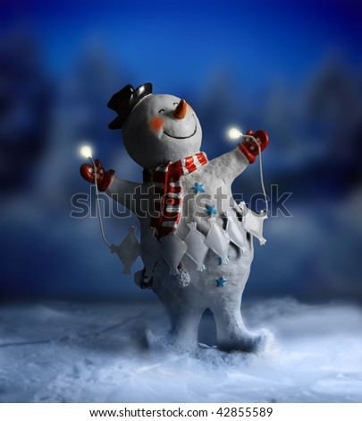 Magical smiling snowman against abstract winter night scene in snow