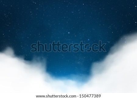 Magical starry night sky with clouds background