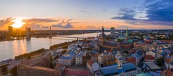 Magical stormy sunset over Riga old town - the capital of Latvia. Stormu clouds forming in the sky. Beautiful Riga at sunset.
